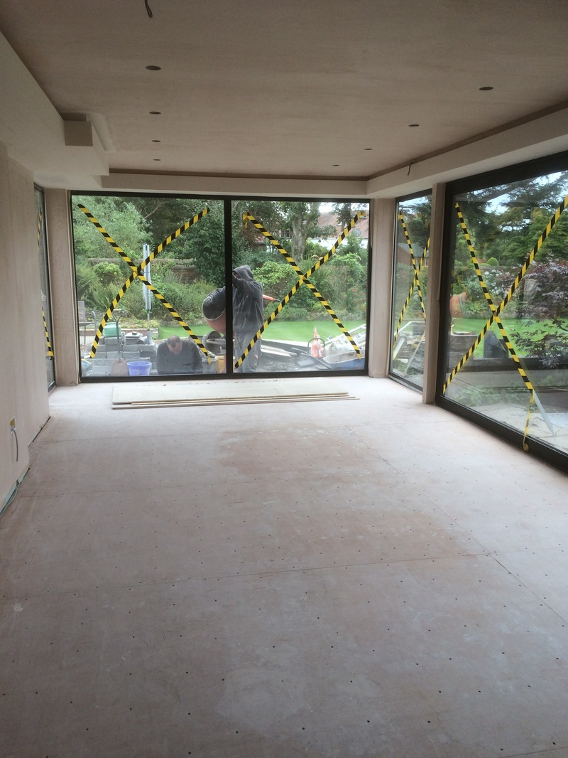 The large windows wrap around the new extension to provide fantastic views of the new garden