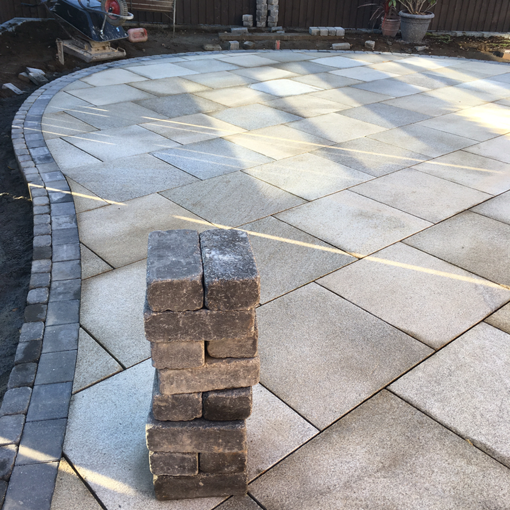 The curved granite patio with edging using Marshalls Tegula block and monoblock
